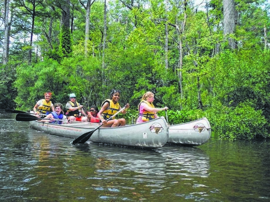 The Girl Scouts of Southern Illinois is offering a variety of camping experiences for girls at different locations in southern Illinois this summer. Canoeing is one of the many outdoor activities that girls can experience at the Girl Scout day camps. Photo: Courtesy Of Girl Scouts Of The USA