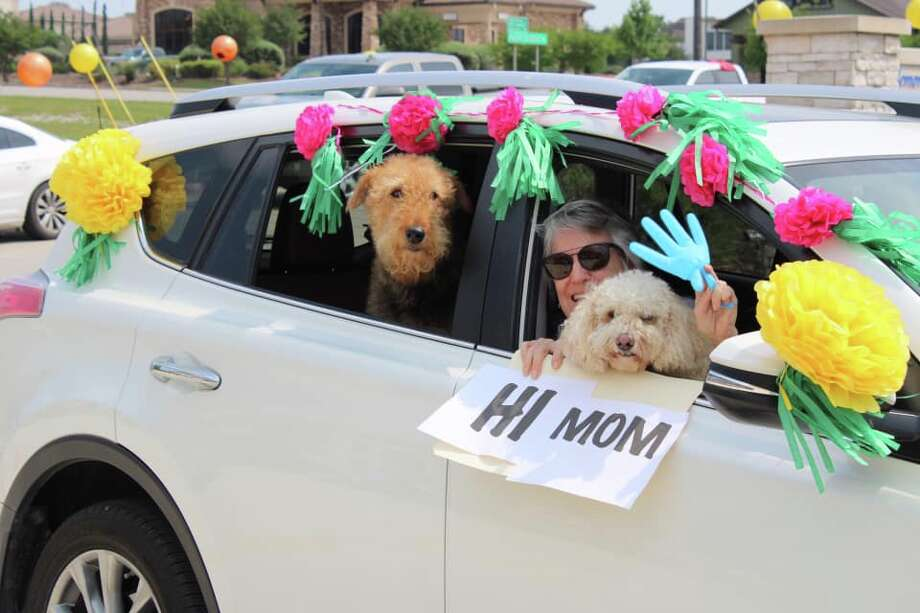 On Tuesday, Memory Care of New Braunfels was filled with tears, laughter and smiles as more than four dozen cars participated in a drive-by parade to say hello to the loved ones they aren't able to visit during the COVID-19 crisis. Photo: Courtesy
