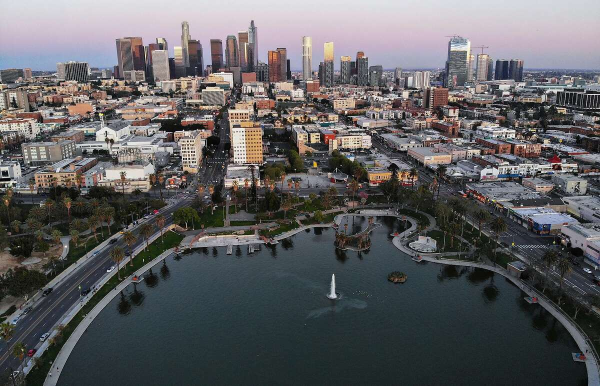 """LOS ANGELES, CALIFORNIA - APRIL 15: An aerial view shows MacArthur Park and downtown in the midst of the coronavirus pandemic, on April 15, 2020 in Los Angeles, California. Environmental Protection Agency (EPA) data from March shows that Los Angeles had its longest stretch of air quality rated as """"good"""" since 1995 as Safer-at-Home orders were issued in response to the spread of COVID-19. (Photo by Mario Tama/Getty Images)"""