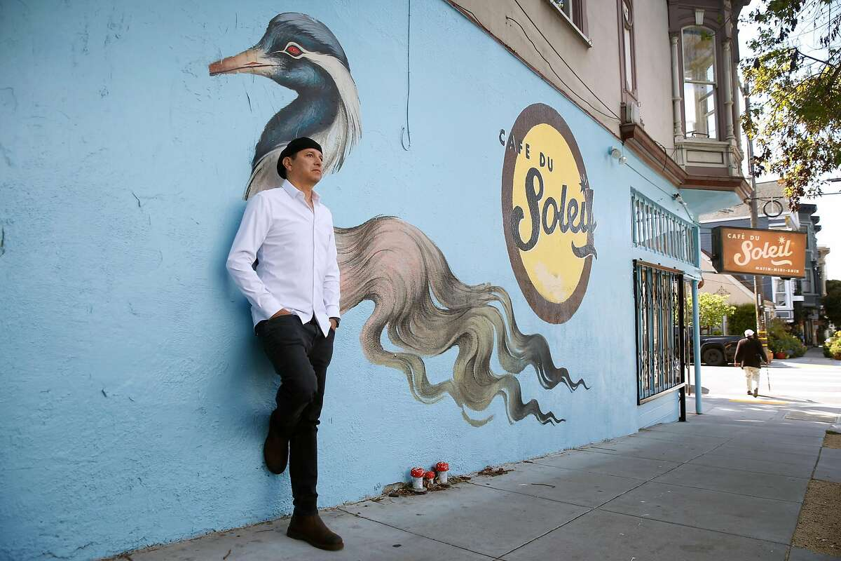 Mustapha Hakkou stands outside his Cafe du Soleil in the Lower Haight neighborhood at Fillmore and Waller streets in San Francisco, Calif. on Thursday, April 23, 2020. Hakkou was forced to shut down his cafe of 15 years after his landlord was unwilling to negotiate on a lower rent.