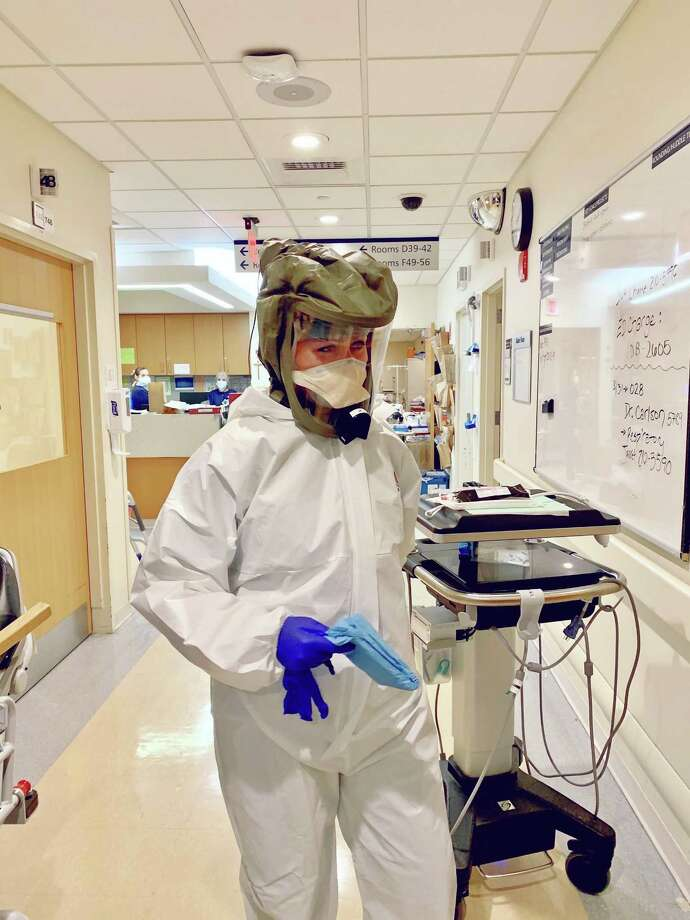 Nurse Allison Gorlo, CRNA at St. Vincent's Medical Center in Bridgeport, wears Personal Protective Equipment, (PPE), which was recently provided by the Grace Farms Foundation in New Canaan. One alliance serves the community to stop the coronavirus, and help people protect themselves from it, and, or those who have it, or COVID-19, its disease. The foundation is located at 365 Lukes Wood Road in New Canaan. Photo: Dr. Theresa Bowling / Contributed Photo / New Canaan Advertiser Contributed