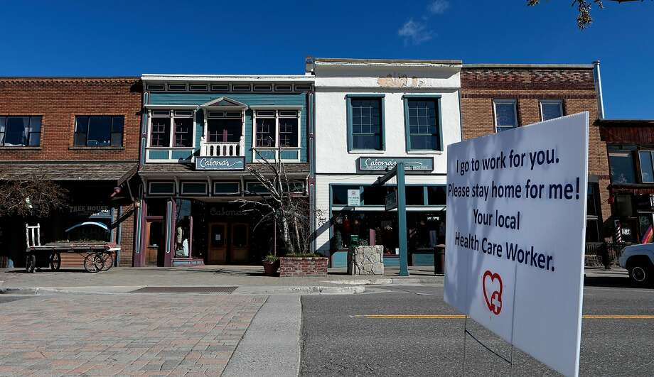 Several of these signs are have been placed around downtown Truckee, Ca., as seen on Thurs. April 23, 2020. Photo: Michael Macor / Special To The Chronicle