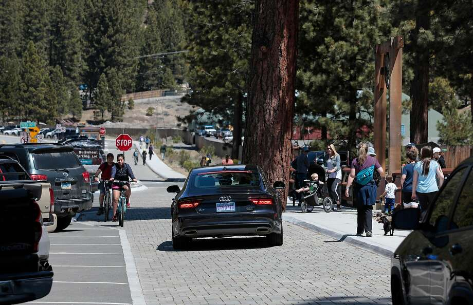 Cars fill the Bullwheel parking lot where visitors walk, bike or run the East Shore Lake Tahoe Trail, in Incline Village, Nv., as seen on Thurs. April 23, 2020. Photo: Michael Macor / Special To The Chronicle