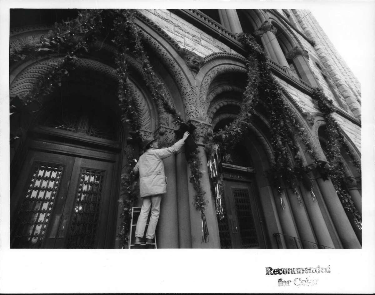 City Hall, Albany, New York - Peter Rumora of Albany Beautification Committee decorates City Hall doorway for Christmas. December 01, 1992 (Jack Madigan/Times Union Archive)