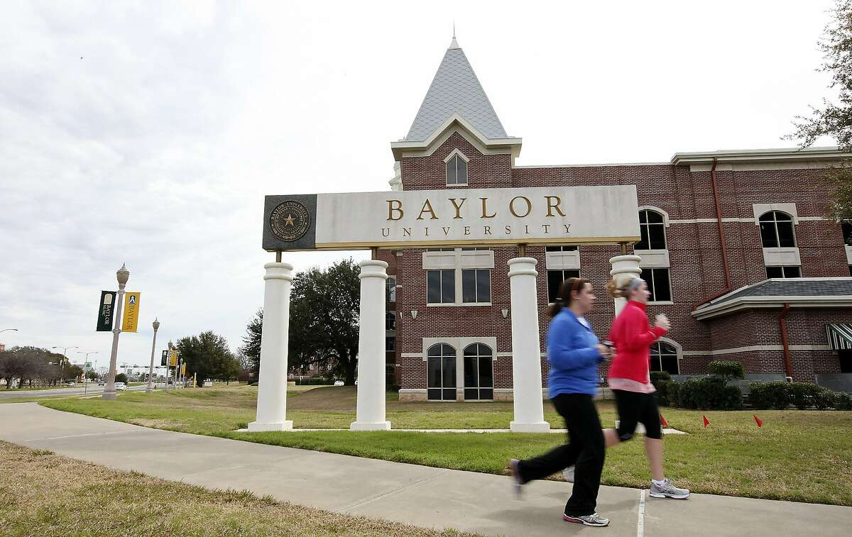 FOR METRO - Students jog around the Baylor University campus Sunday Feb. 12, 2012 in Waco, TX. Baylor University freshman William Patterson was found dead in his burning car early Thursday on Eastland Lake Road near the campus. (PHOTO BY EDWARD A. ORNELAS/SAN ANTONIO EXPRESS-NEWS)