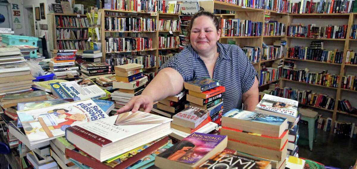 Sabrina Caldwell tends to her store, The Book Haus in New Braunfels. The COVID-19 pandemic forced bookstores, like most businesses, to shutter their doors and rely on curbside pickup, delivery and mail order to keep the lights on.