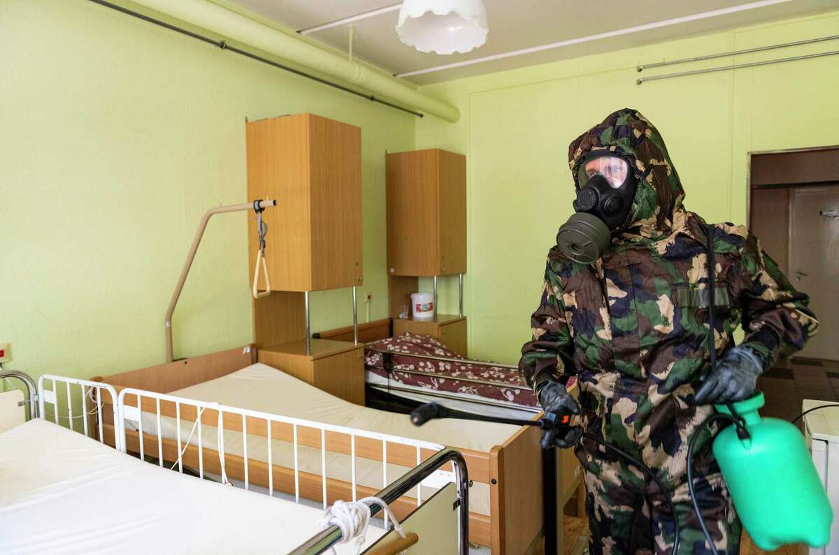Across the world, including in Connecticut, nursing home workers are struggling to cope with the toll of caring for a vulnerable population during a pandemic. A workers' union said Friday that Connecticut officials are not doing enough to address employee safety. A Hungarian soldier wearing hazmat suit disinfects a nursing home in an effort to stop the spread of novel coronavirus and COVID-19 in Nyiregyhaza, Hungary, on April 24, 2020.
