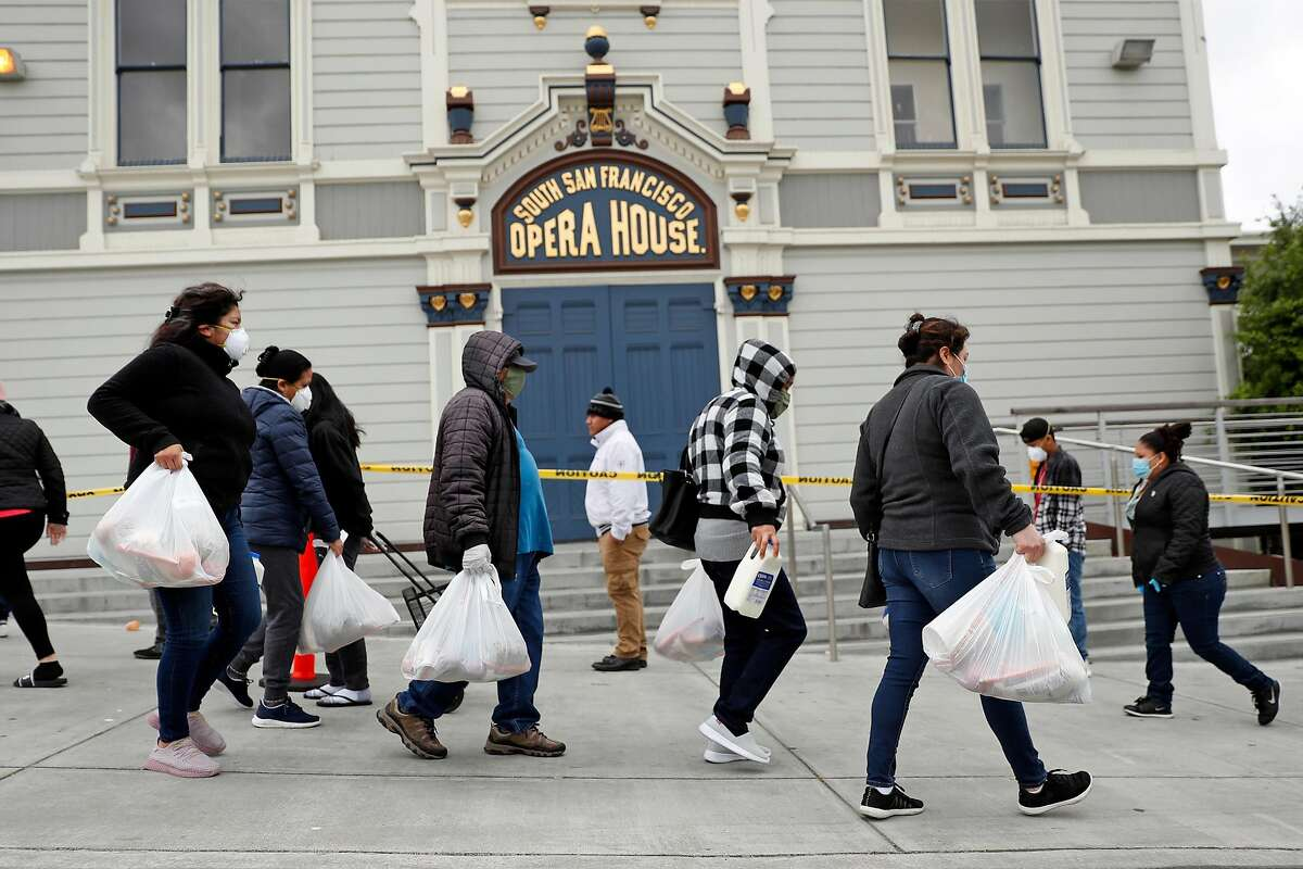SF-Marin Food Bank hands out 1600 food bags at a pop-up pantry at Bayview Opera House in San Francisco, Calif., on Monday, April 20, 2020.