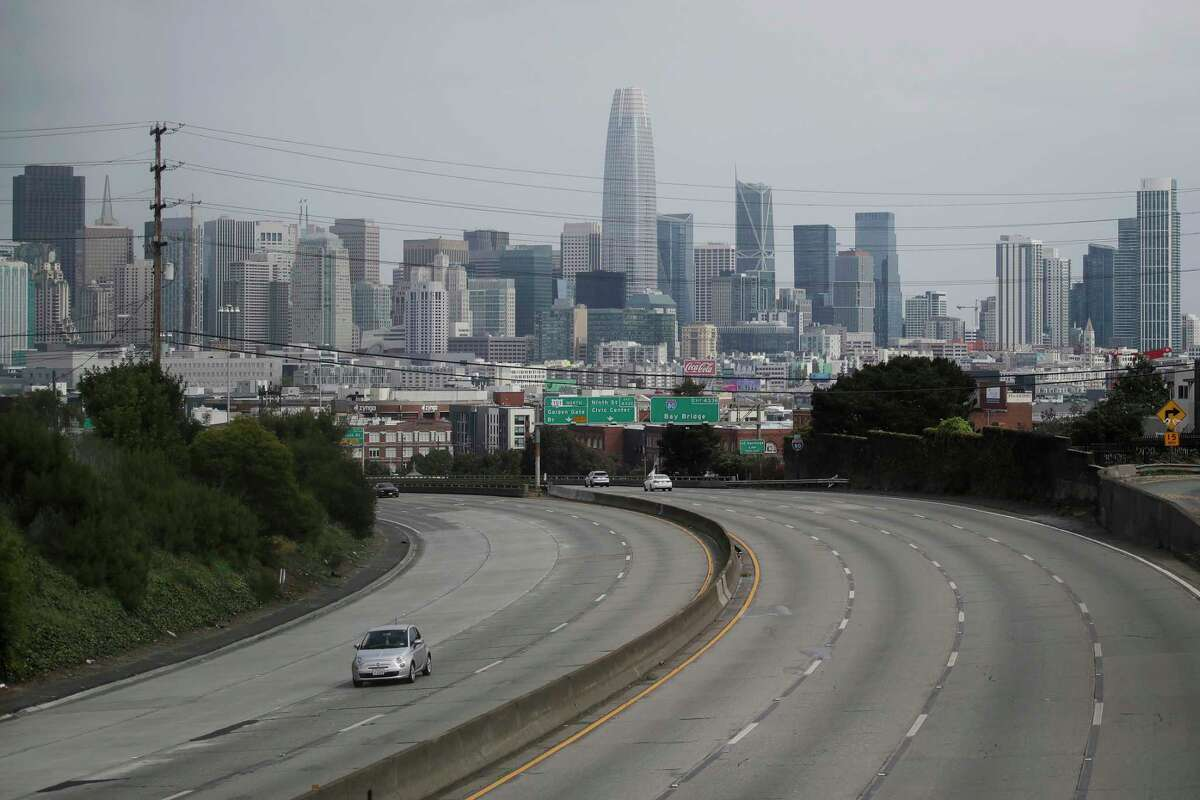 FILE - In this March 29, 2020 file photo, light traffic is seen on Highway 101 in San Francisco, amid coronavirus concerns. With most states under stay-at-home orders from governors, traffic is down almost everywhere, and that means lower crash rates and fewer insurance claims. As a result, many auto insurance companies are cutting rates, sending checks or offering credits on monthly bills. (AP Photo/Jeff Chiu, File)