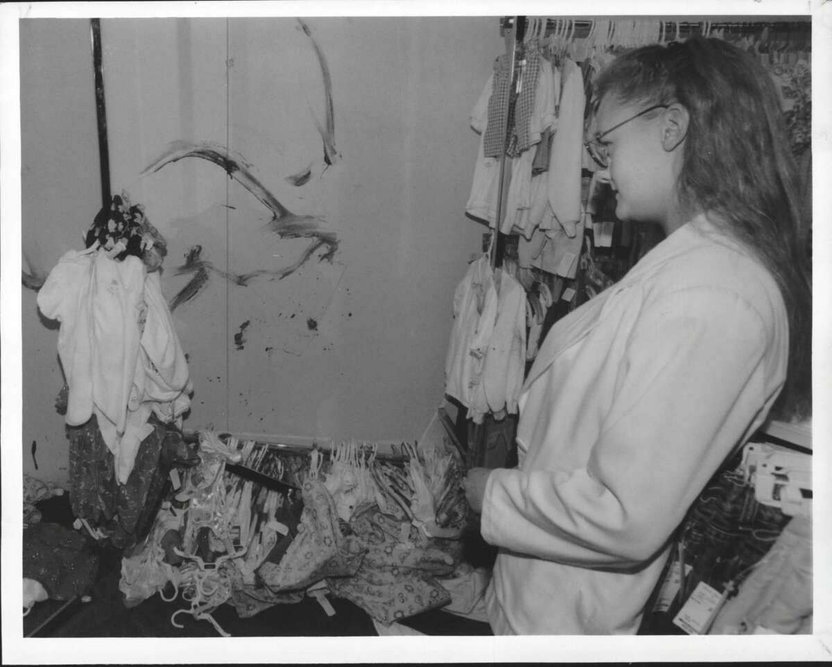 Twenty-five years ago, sales associate Jessica Barrow surveyed the damage caused when a deer ran through the Peter Harris Clothing Store on Troy-Schenectady Road in Colonie. April 25, 1995 (James Goolsby/Times Union Archive)