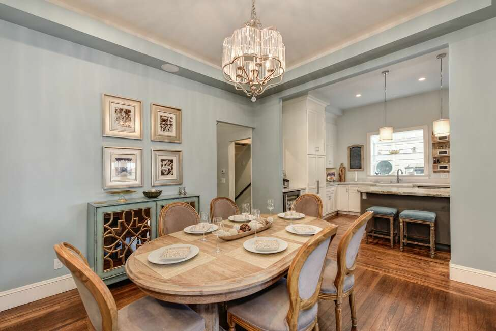 The dining room features 10-foot ceilings and can easily fit a table for eight.