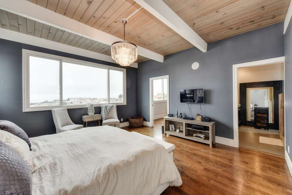 The master bedroom sits on the top floor and has sweeping Pacific Ocean views.
