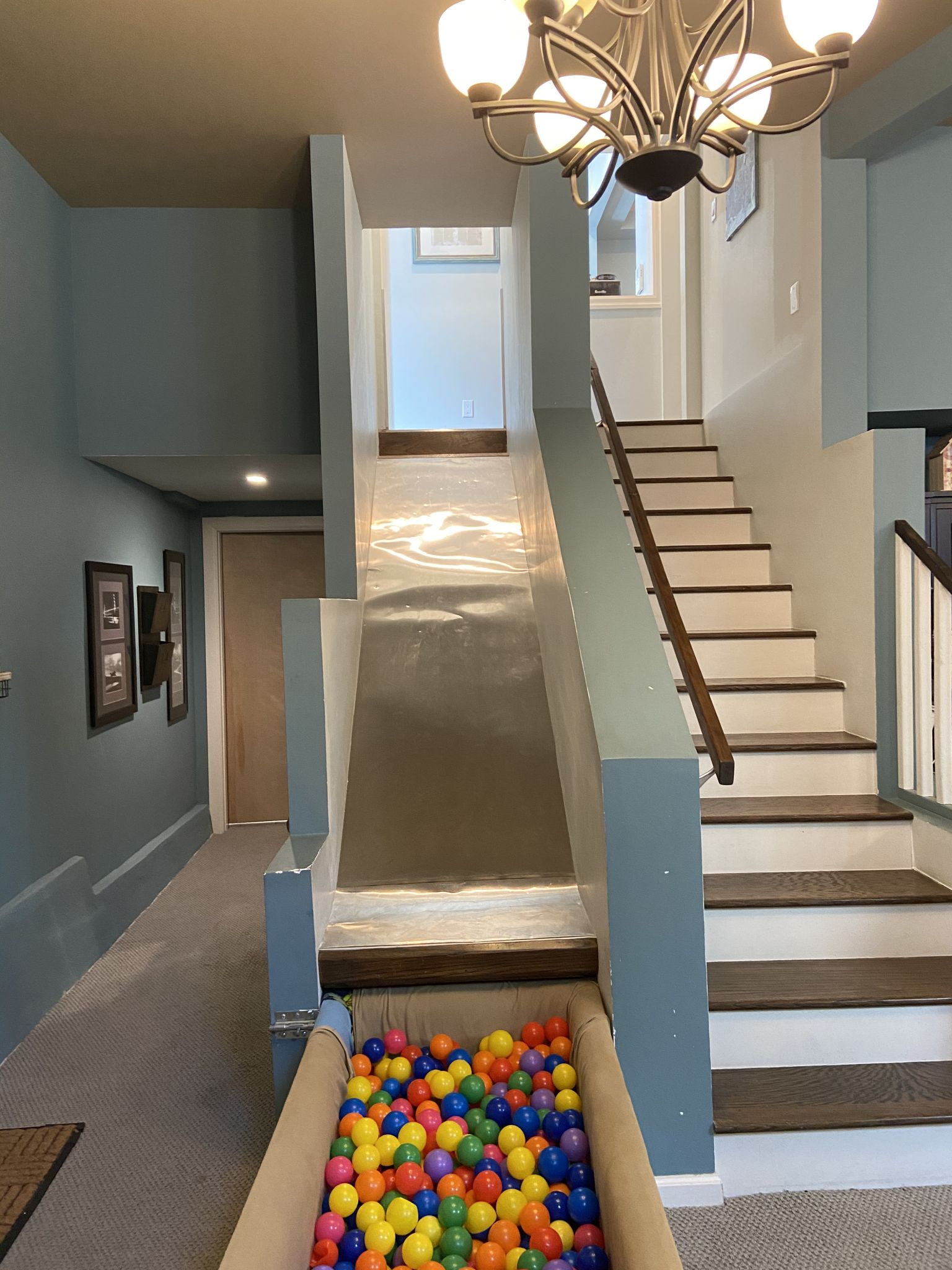 The slide runs into a ball pit that can be pushed away when not in use.
