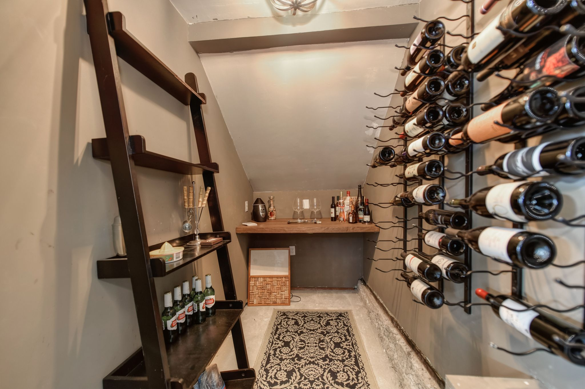 A wine cellar features a bar area for tastings and was built with mold-resistant sheet rock and has a fan for humidity control.