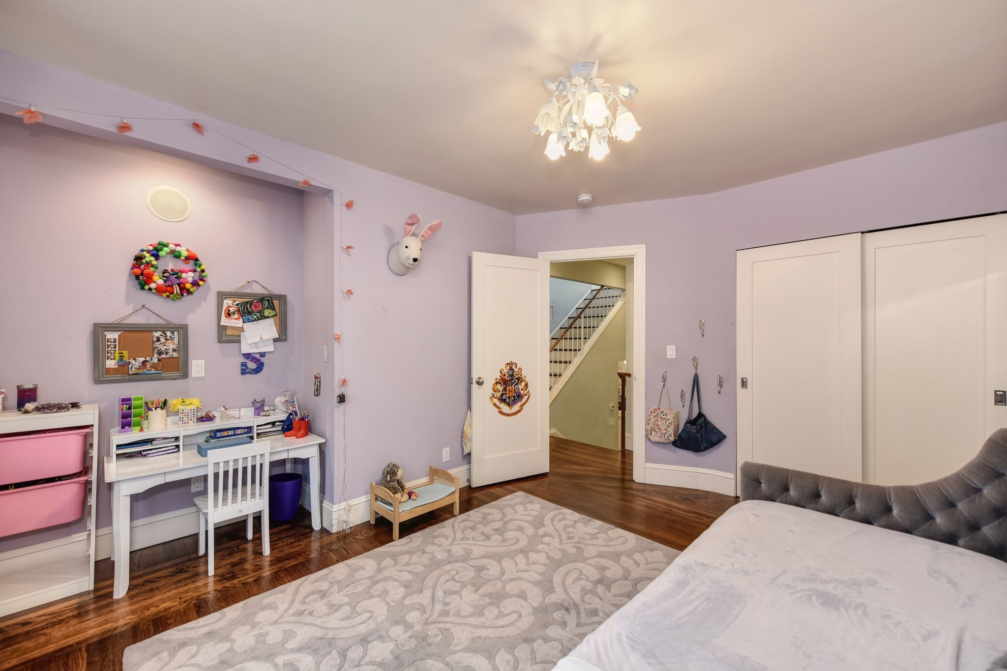 The two additional bedrooms overlook the garden and feature large closets with organizers.