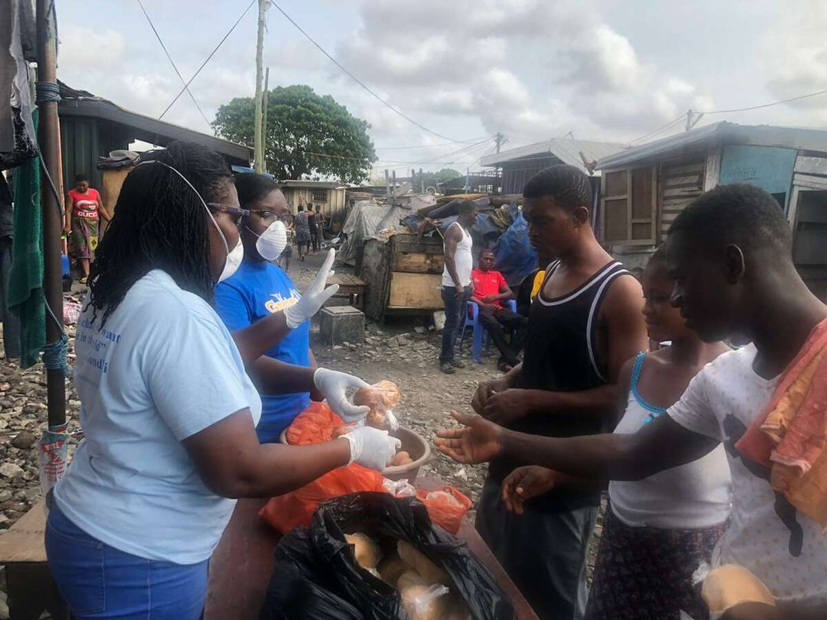 Westminster Presbyterian donates funds for free breakfast programs, food distribution and PPE for its sister churches in Ghana, Sierra Leone and Liberia that are continuing their work during the pandemic. Here, masked volunteers from the Tema Redemption church in Ghana deliver meals to a village.