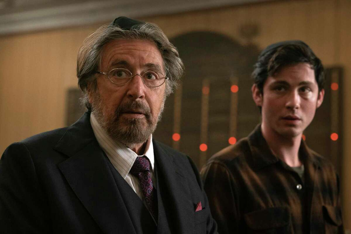 """This image released by Amazon Studios shows Al Pacino, left, and Logan Lerman in a scene from """"Hunters."""" In Amazona€™s a€œHunters,a€ an unlikely group of 1970s New Yorkers target German Nazis who have brought their genocidal quest to America. (Christopher Saunders/Amazon Studios via AP)"""