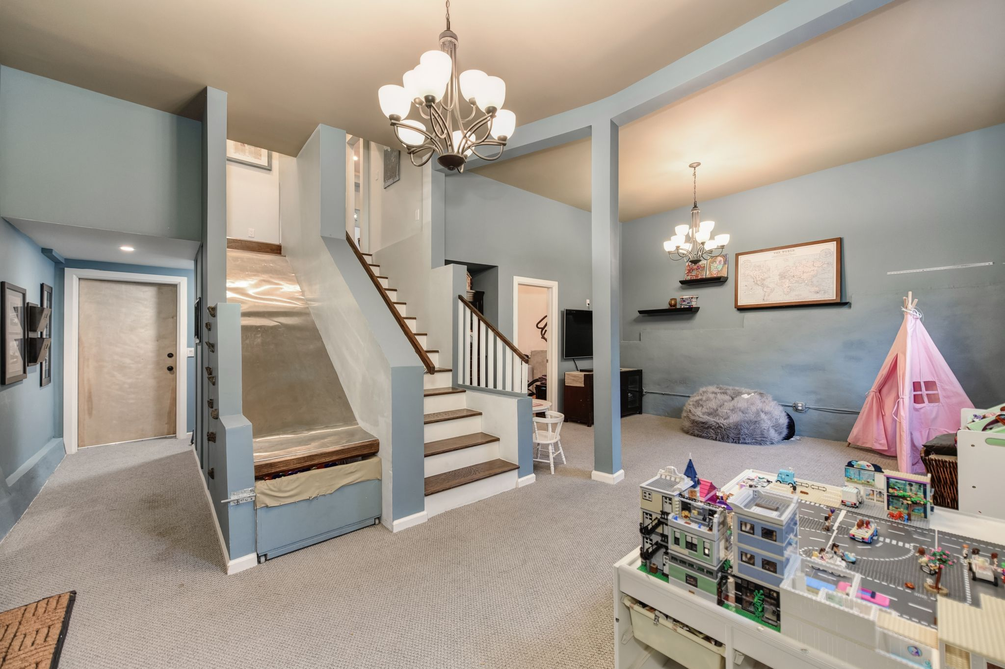 The lower level has 11-foot ceilings and is a perfect space for a play room or media room.
