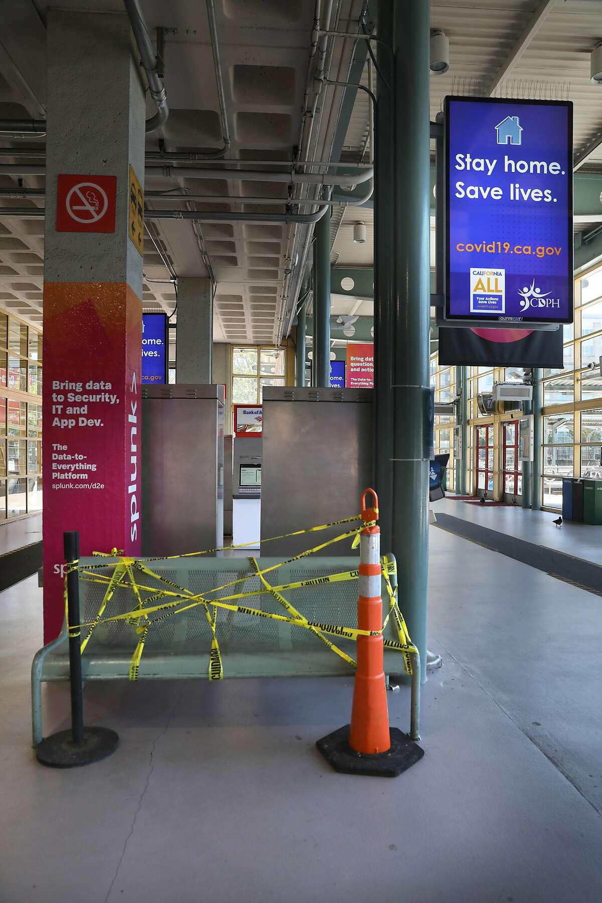 Public bench cordoned off seen at Caltrain Station at 4th and King Streets on Thursday, April 23, 2020, in San Francisco, Calif.
