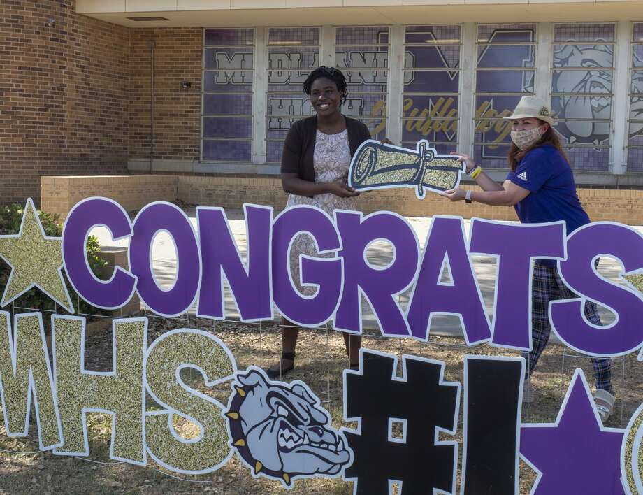 Midland High Principal Leslie Sparacello stands with Opeyemi Olubajo the #1, valedictorian, senior at MHS 04/24/2020 in front of Midland High with signage by Card My Yard. Tim Fischer/Reporter-Telegram Photo: Tim Fischer/Midland Reporter-Telegram