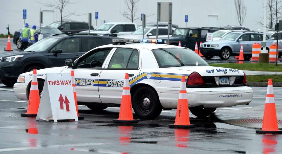 A police cruiser is stationed at a COVID-19 test site at the corner of Long Wharf and Sargent Drive in New Haven on April 24, 2020. Photo: Arnold Gold, Hearst Connecticut Media / New Haven Register