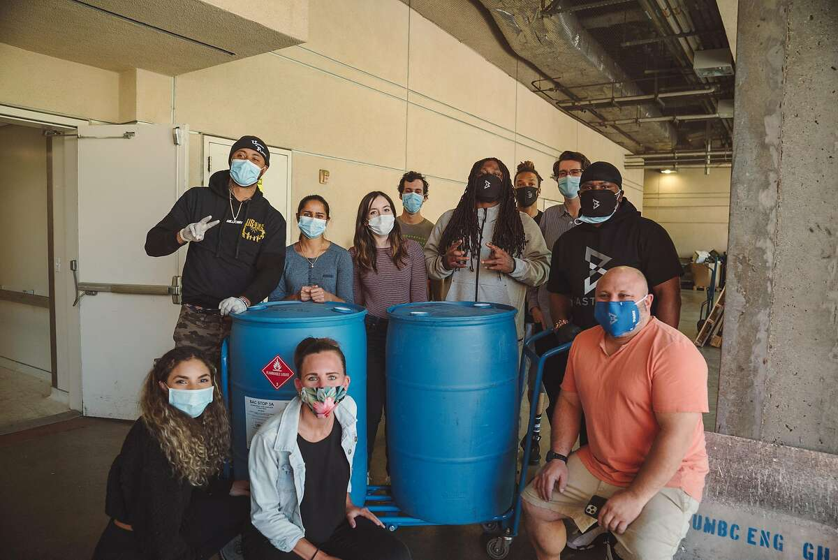 Marshawn Lynch, fifth from right, and Jeremy Castro, far right, pose with�UCSF Mission Bay campus Friday.