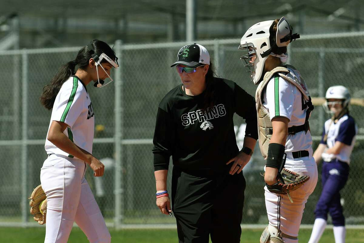 Spring Head Softball Coach Julie Wyrick, center, holds a conference with her freshman pitcher Bella De Los Santos, left, and junior catcher Jayla Park during their bracket game against Klein Cain at Cy Park High School during the Cy-Fair Softball Tournament on March 5, 2020.