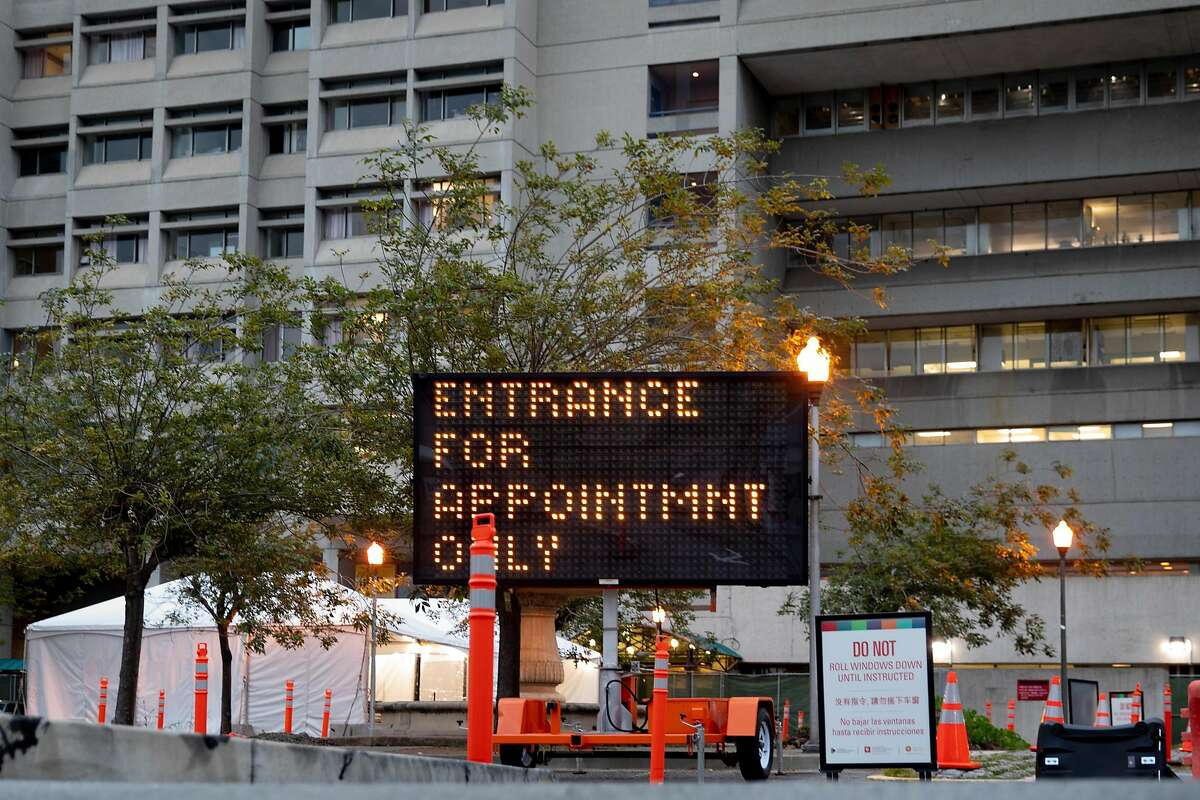 An appointment-only Coronavirus drive-thru testing site is seen in the parking lot of San Francisco General Hospital in San Francisco, Calif. Saturday, April 11, 2020.