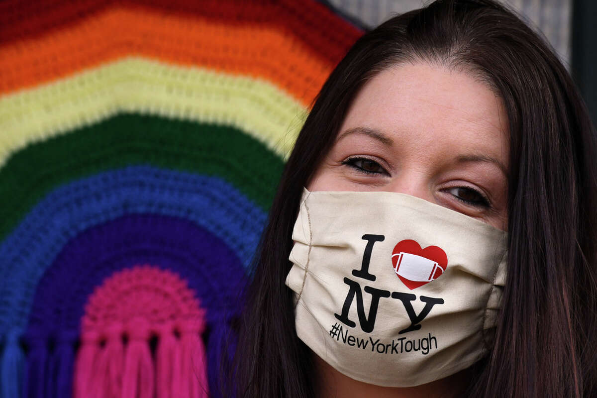 Maria Fitch wears one of her self-styled masks which she sells on Etsy, an e-commerce website focused on handmade goods, on Friday, April 24, 2020, at her home in Colonie, N.Y. (Will Waldron/Times Union)