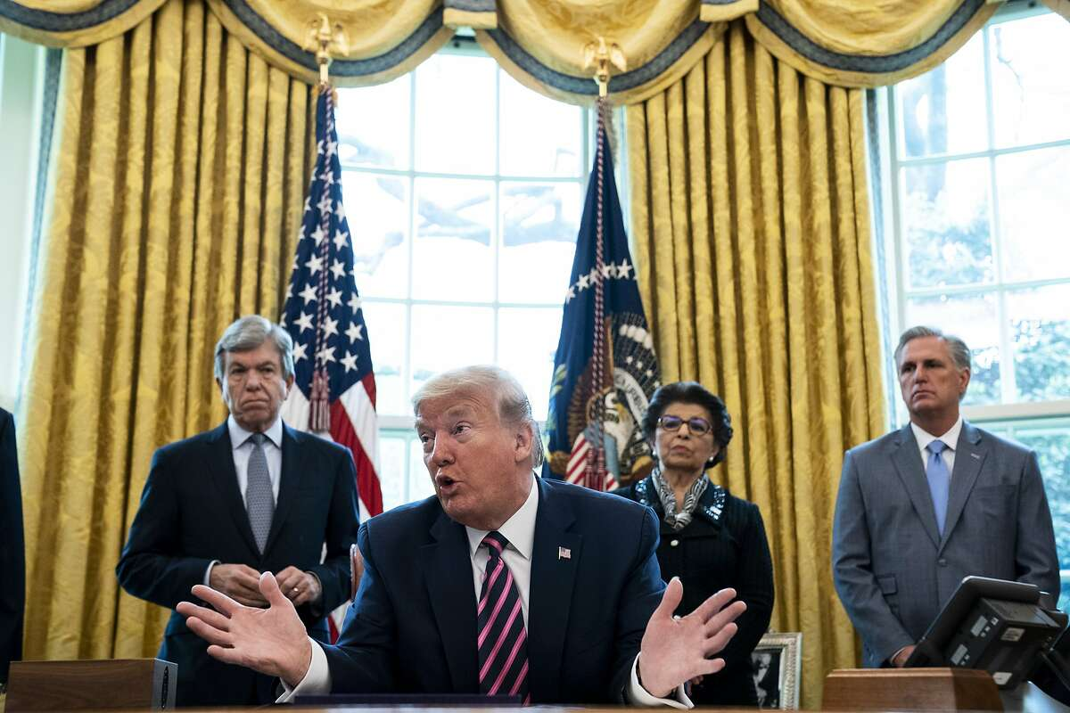 President Donald Trump participates in a signing ceremony for the Paycheck Protection Program and Health Care Enhancement Act, with members of his administration and Republican lawmakers in the Oval Office of the White House in Washington on April 24th, 2020.