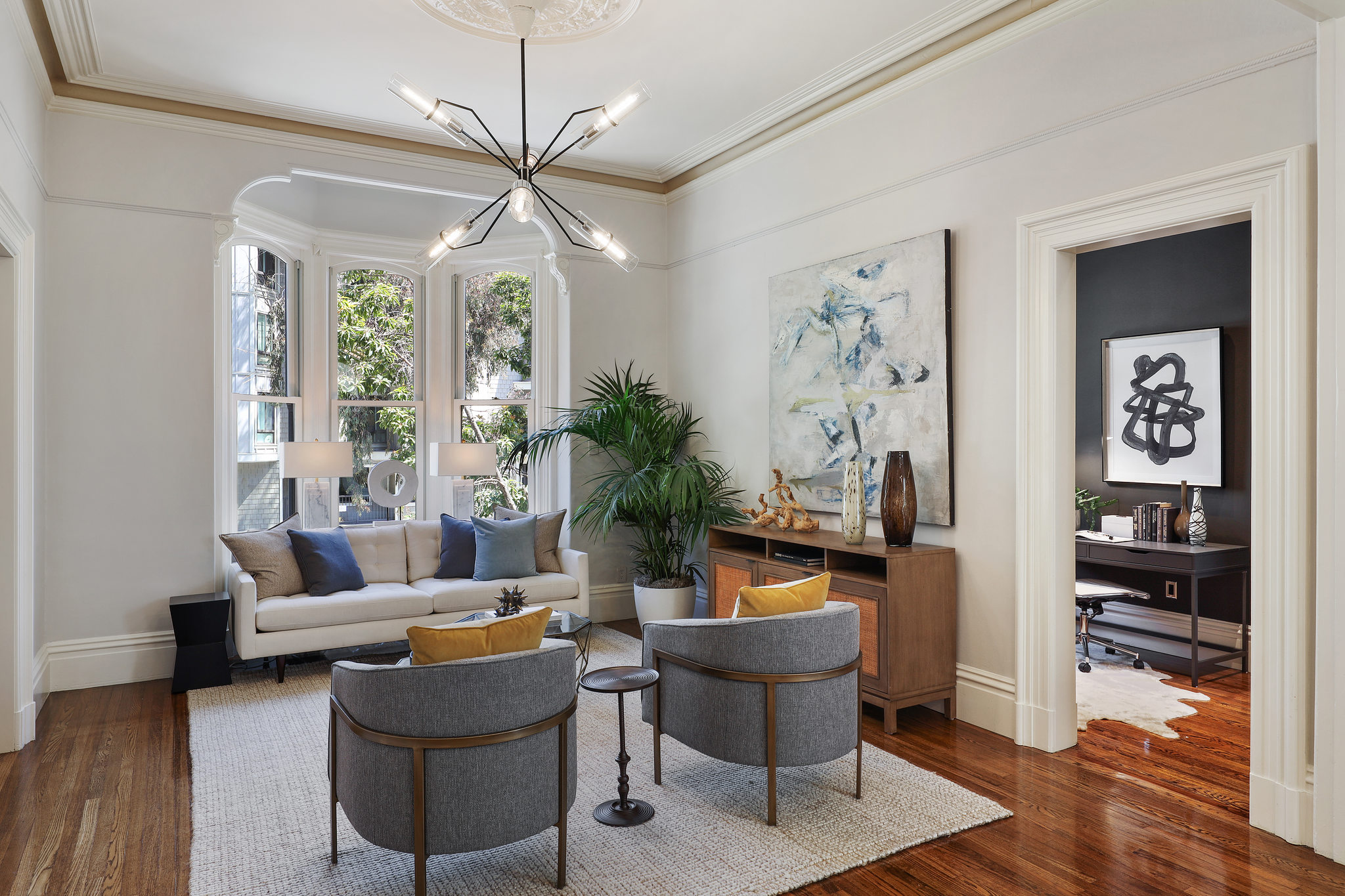 Gorgeous Victorian window seats made modern by light fixtures and furnishings.