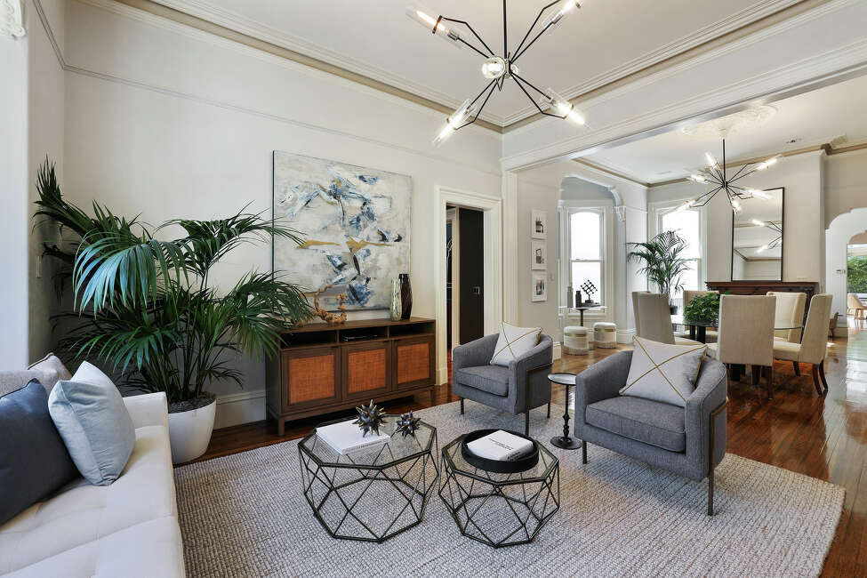 The living room and dining room are one open space - a modern fleshing out of the still-present Victorian bones.