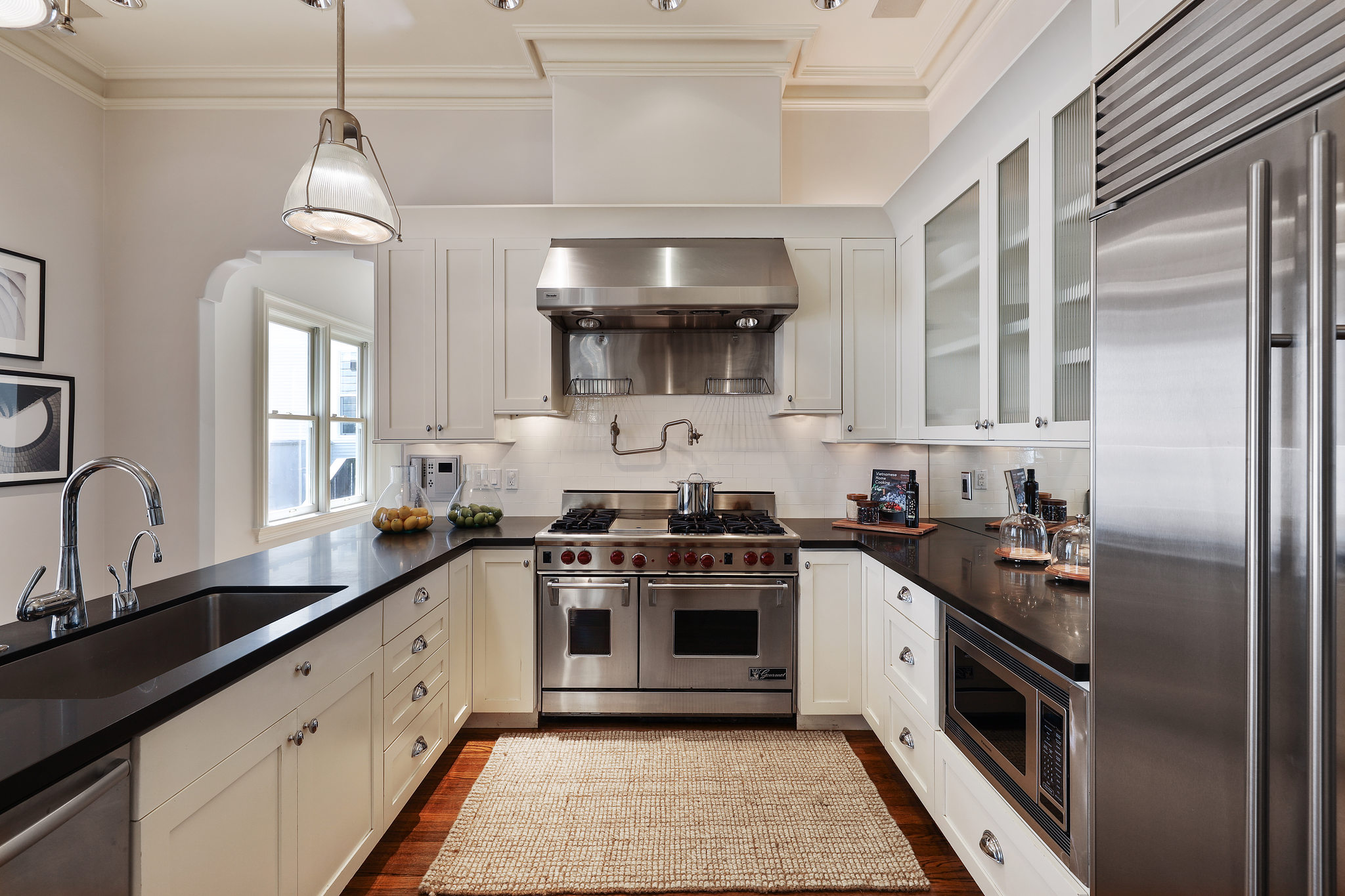 A very modern kitchen with storage, counter space, and appliances for the modern chef.