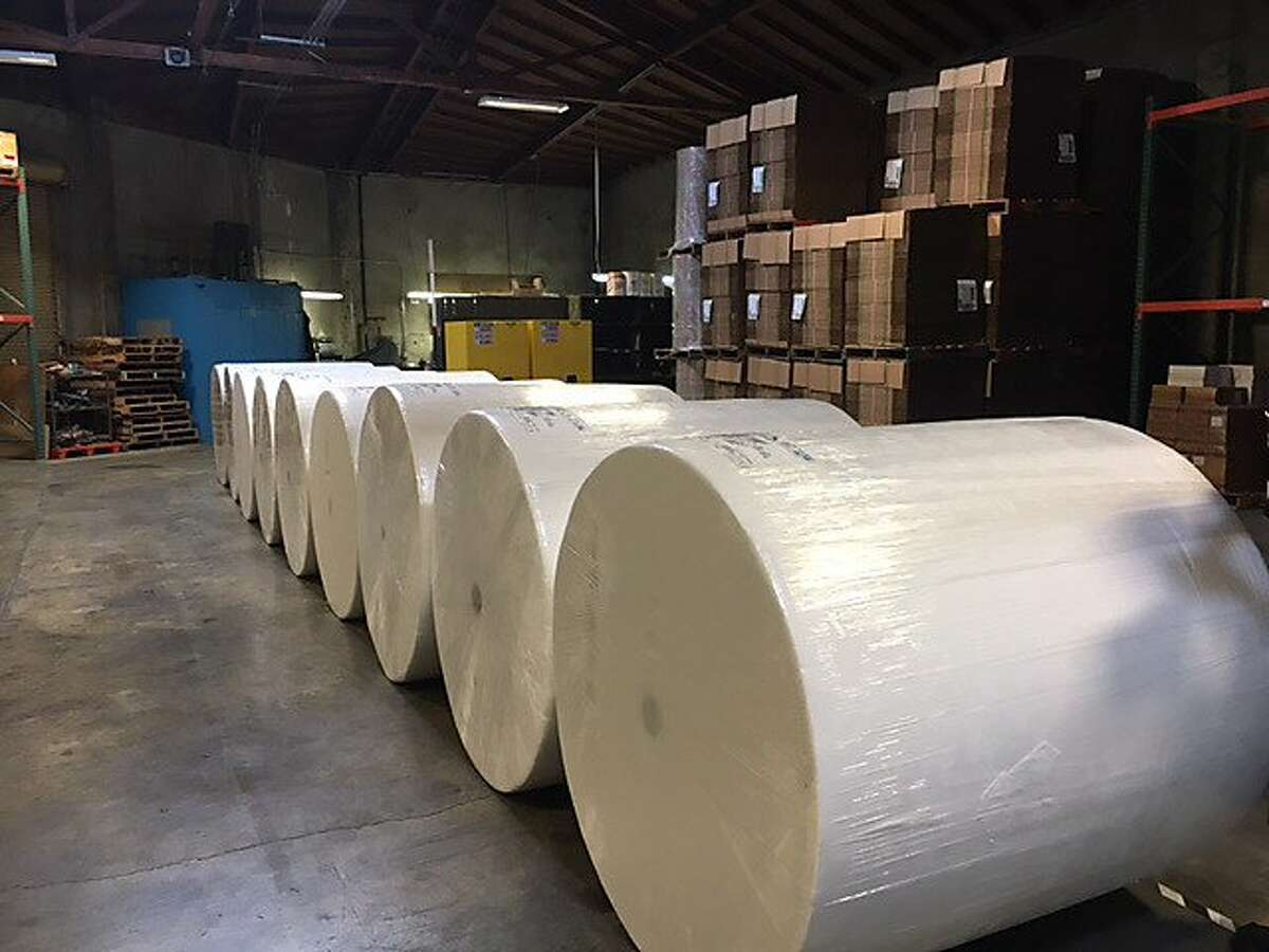 1000-pound rolls of toilet paper await repackaging at Lighthouse for the Blind plant in San Leandro