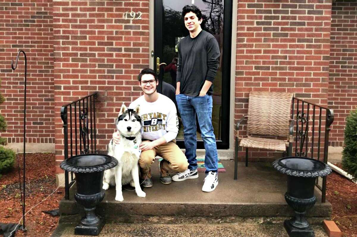 Bryant University sophomores Benjamin Clemmey, left, and Jamil Mansour pose outside Clemmey's home in Middletown Friday afternoon. Mansour, who is from Beruit, Lebanon, has been staying with the family since the college was close due to the coronavirus epidemic.