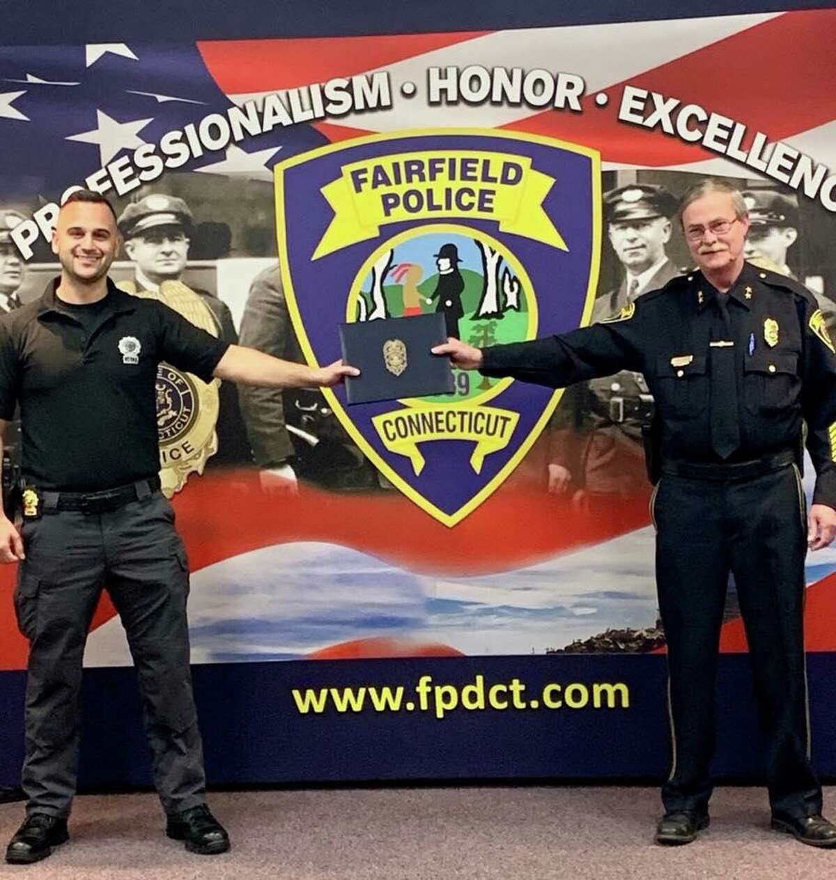 Chief Christopher Lyddy presented Detective Michael Clark with an award for distinguished service on Tuesday, April 21., 2020. Due to social distancing restriction, the chief and detective are standing a safe distance apart.