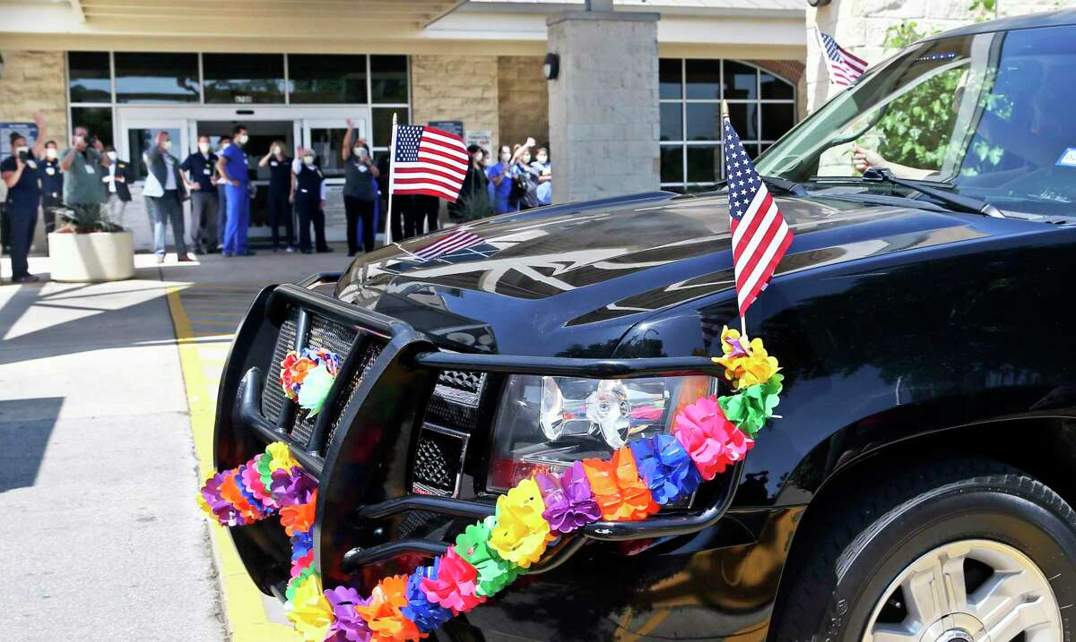 Decorated vehicles cruise by the lobby of Methodist Hospital Texsan as the city of Balcones Heights holds its own Fiesta parade Friday.