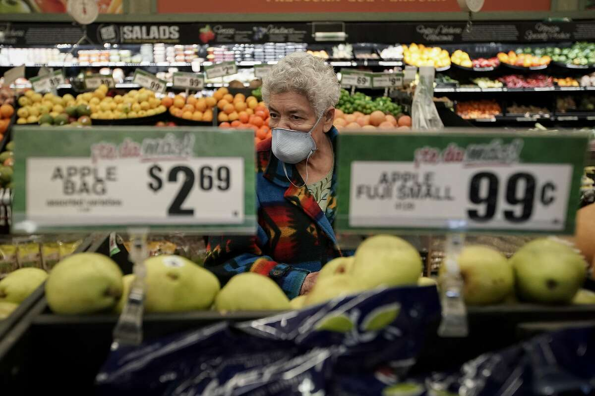 FILE - In this March 17, 2020 file photo, Carmen Zamora shops at Northgate Gonz�lez Market in Santa Ana, Calif., during an early-hour shopping time for those over 65 and the disabled. Taxpayers will pay restaurants to make three meals a day for California's millions of seniors during the coronavirus pandemic, Gov. Gavin Newsom announced Friday, April 24, 2020, putting the industry back to work and generating sales tax collections for cash-strapped local governments. California has about 5.7 million people 65 and older, but not all of them will be eligible. Newsom said seniors must have either been exposed to the virus, have a high risk for potential exposure or a compromised immune system. (AP Photo/Chris Carlson)