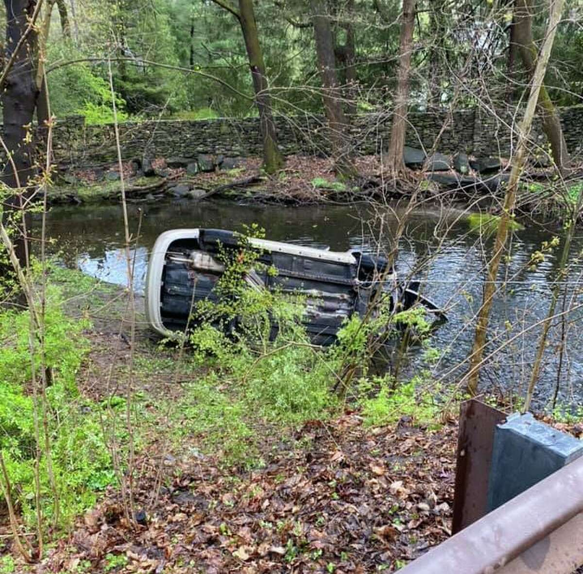A vehicle down an embankment and in water off Glenville Road in Greenwich, Conn., on April 24, 2020.