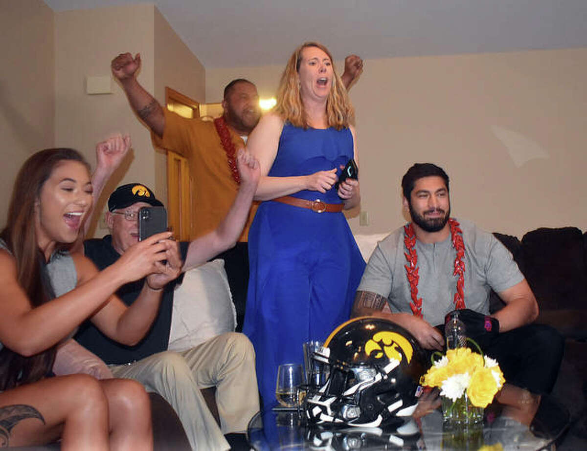 The Epenesa family celebrates when AJ's name is called by Commissioner Roger Goodell in the NFL Draft on Friday.