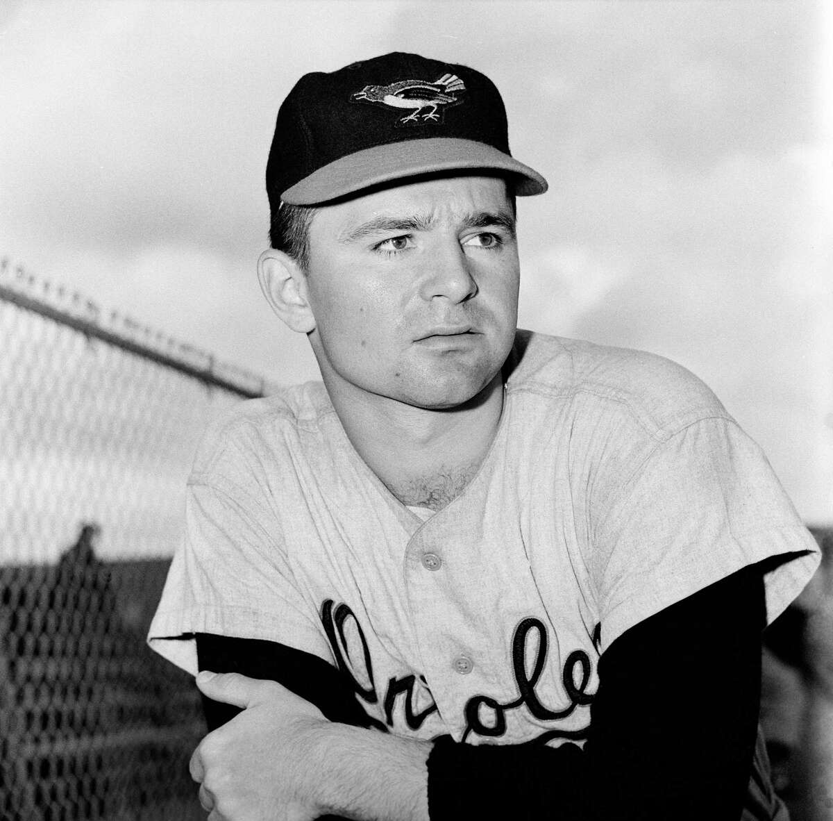 """FILE - This is a 1959 file photo showing Baltimore Orioles minor league pitcher Steve Dalkowski posed in Miami, Fla. Dalkowski, a hard-throwing, wild left-hander who inspired the creation of the character Nuke LaLoosh in the movie """"Bull Durham"""" but never pitched in a big league game, died April 19, 2020, at the Hospital of Central Connecticut in New Britain. He was 80. His sister, Patricia Cain, said Friday, April 24, 2020, he had several pre-existing conditions that were complicated when he became infected with the novel coronavirus. (AP Photo/File)"""
