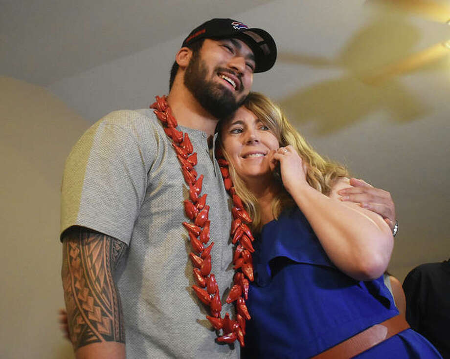 AJ Epenesa and his mom Stephanie embrace at the family's Glen Carbon home after he was selected by the Buffalo Bills in the second round of the NFL Draft Friday. Photo: Matt Kamp | For The Telegraph