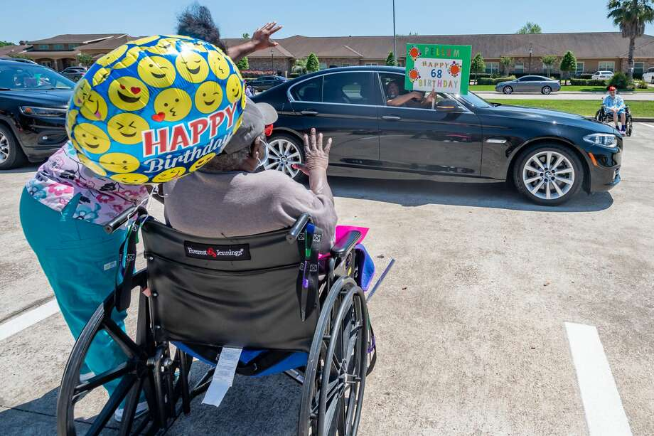 The family of Gregory Pellum and the staff made sure to celebrate his 68th birthday with him during the family parade. Family members in about a hundred cars paraded through the parking lot to see the nursing home residents of Focused Care at Summer Place on April 24, 2020. Fran Ruchalski/The Enterprise Photo: Fran Ruchalski/The Enterprise / ? 2020 The Beaumont Enterprise