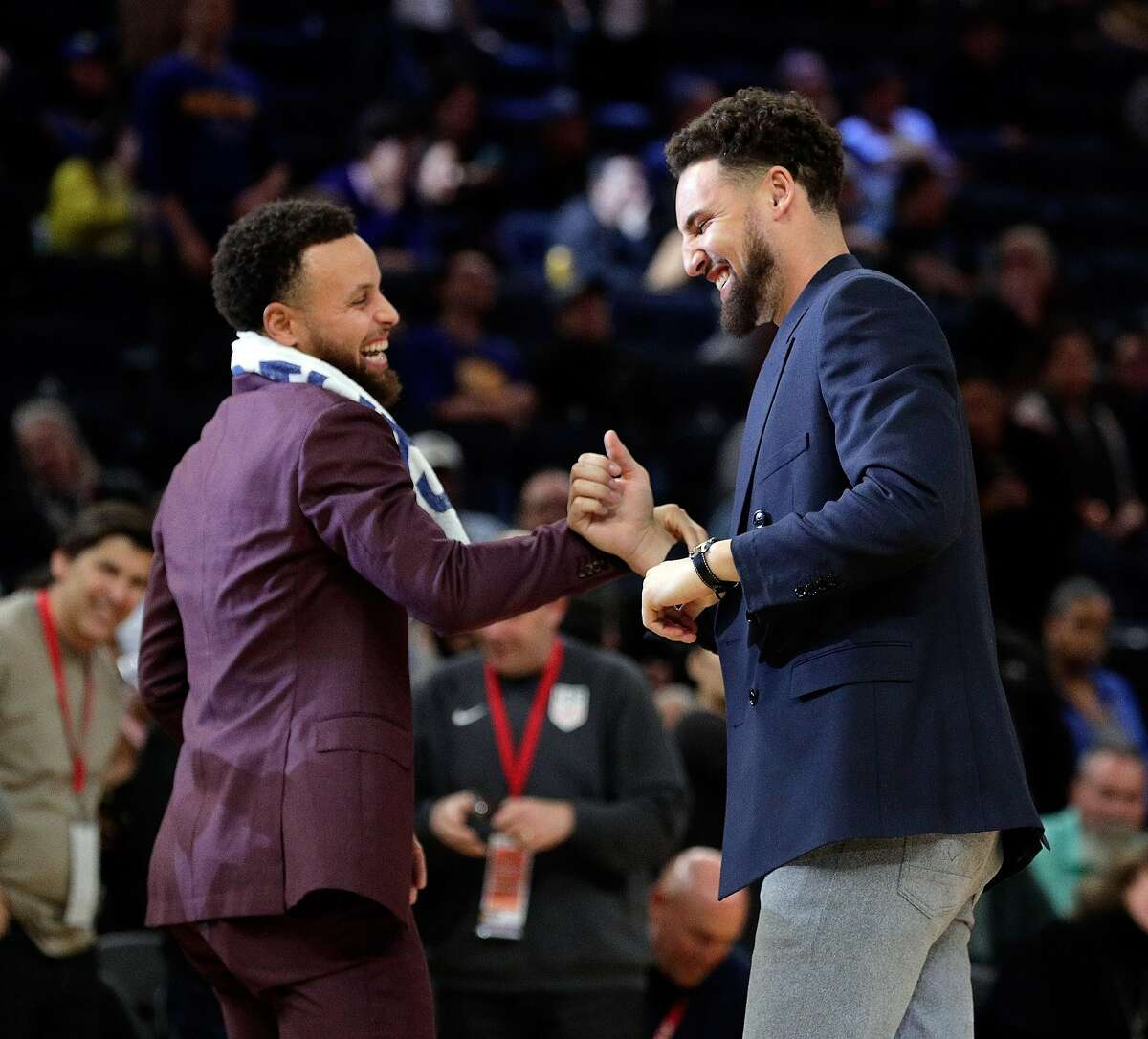 Stephen Curry (30) and Klay Thompson (11) share a laugh during a timeout in overtime as the Golden State Warriors played the Denver Nuggets at Chase Center in San Francisco, Calif., on Thursday, January 16, 2020.
