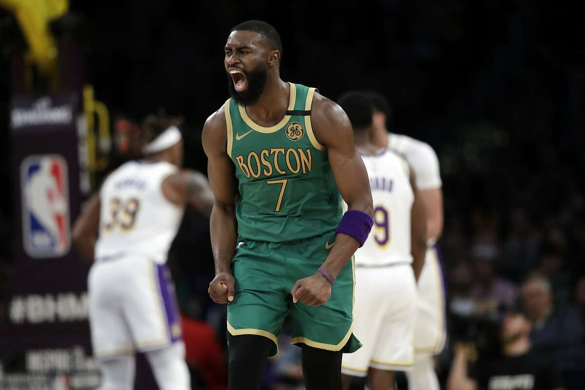 Boston Celtics' Jaylen Brown (7) reacts after making a 3-point basket during the second half of an NBA basketball game against the Los Angeles Lakers Sunday, Feb. 23, 2020, in Los Angeles. (AP Photo/Marcio Jose Sanchez)