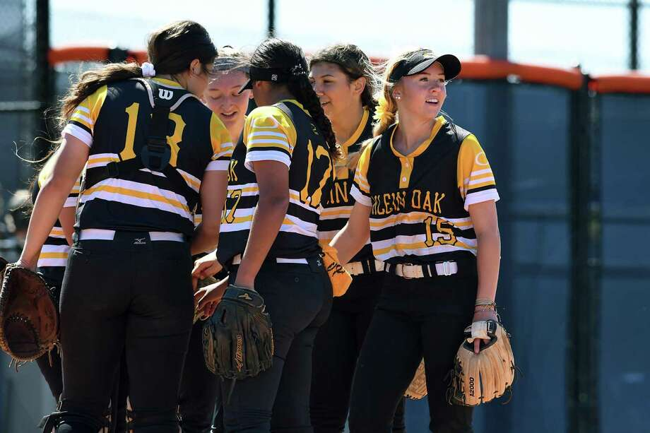 Klein Oak junior second baseman Allie Saville, right, is all smiles as she and her teammates get ready to play defense against Bridgeland during their bracket game at Bridgeland High School during the Cy-Fair Softball Tournament on March 5, 2020. Photo: Jerry Baker, Houston Chronicle / Contributor / Houston Chronicle