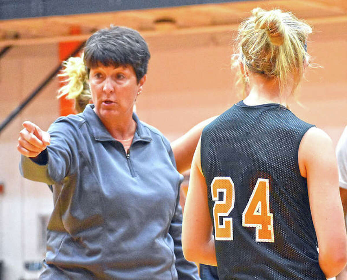 Former Edwardsville girls basketball coach Lori Blade gives instruction during a summer game last year.