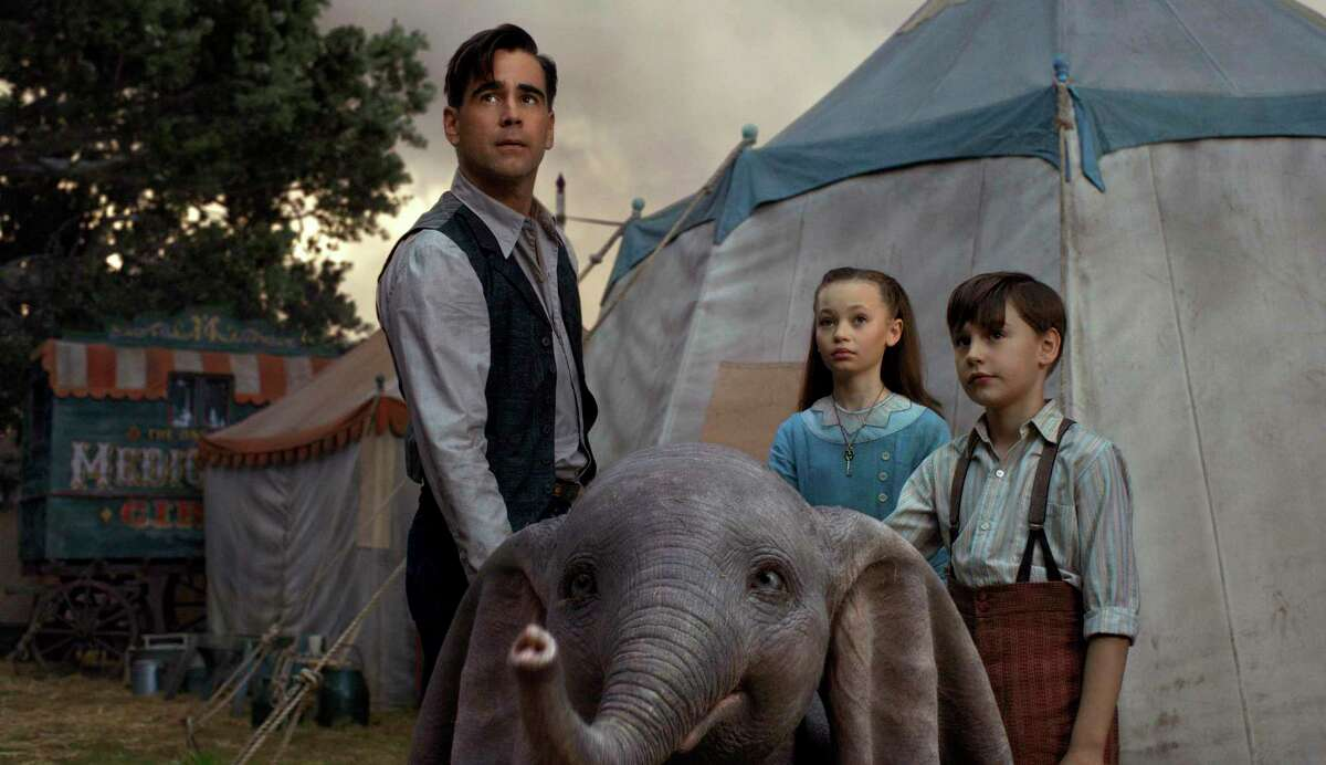 """This image released by Disney shows Colin Farrell, Nico Parker and Finley Hobbins in a scene from """"Dumbo."""""""