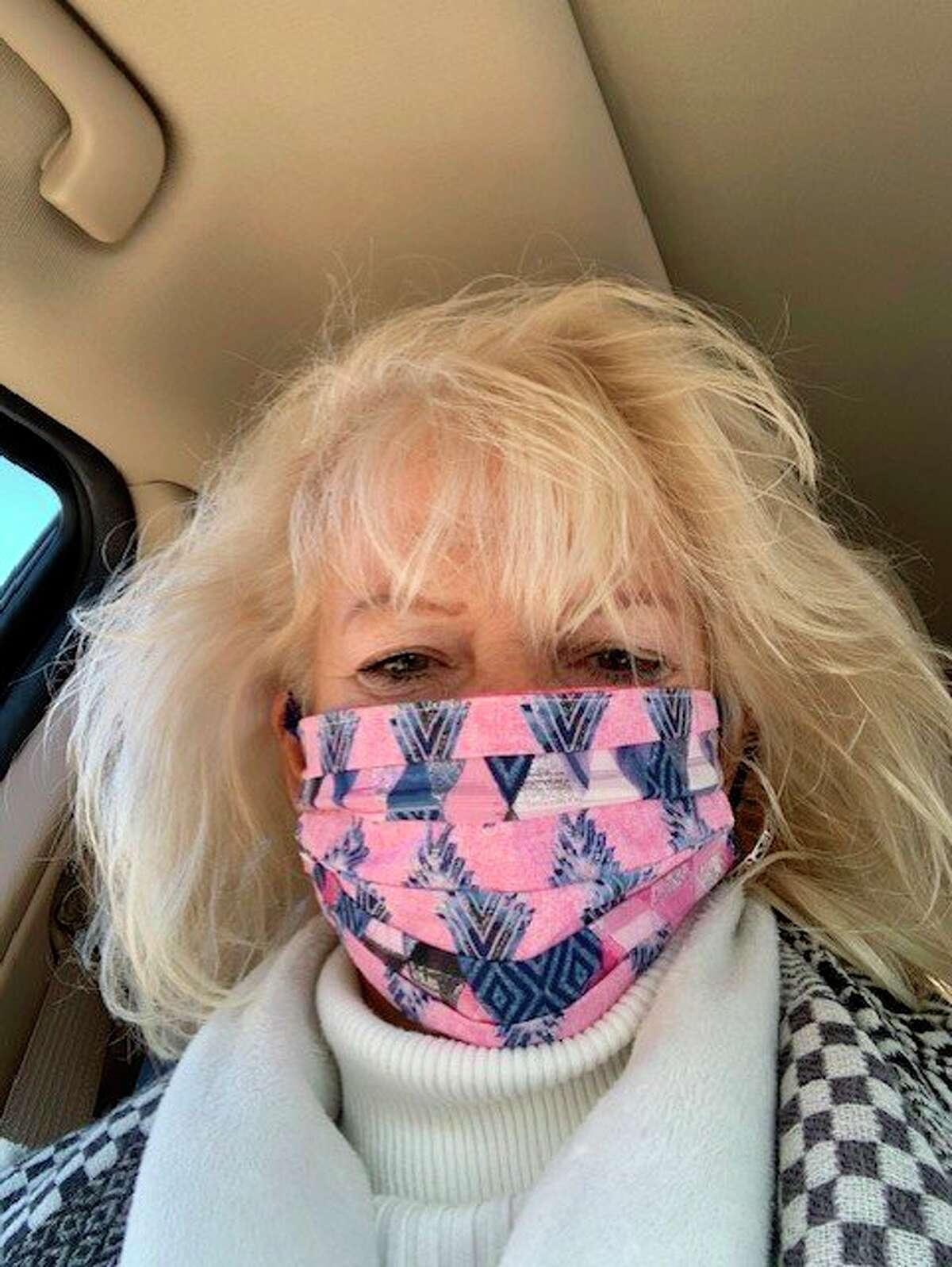 Debbie Makowski shows off one of the colorful masks that she created for for the fight against COVID-19. (Courtesy photo)
