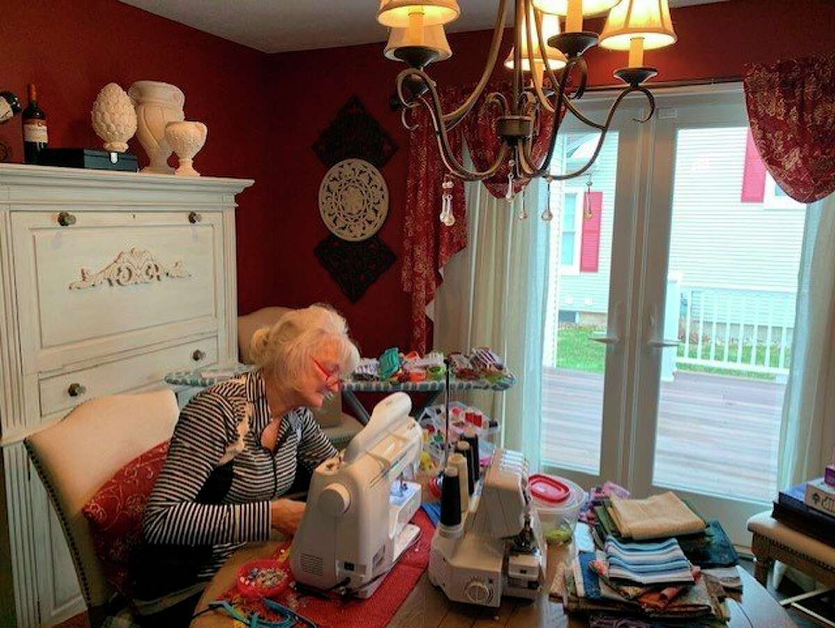 """Local woman Debbie Makowski continues her """"labor of love"""" creating face masks for people in the community. She has created more than 530 masks of many colorful designs over the past several weeks. (Courtesy photo)"""